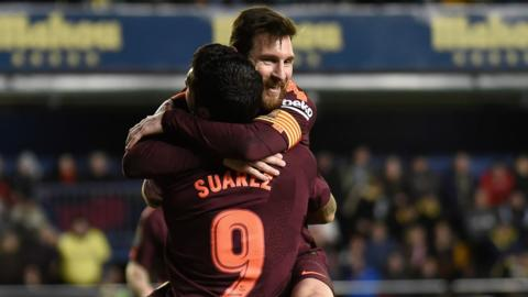 Luis Suarez and Lionel Messi celebrate a Barcelona goal against Villarreal