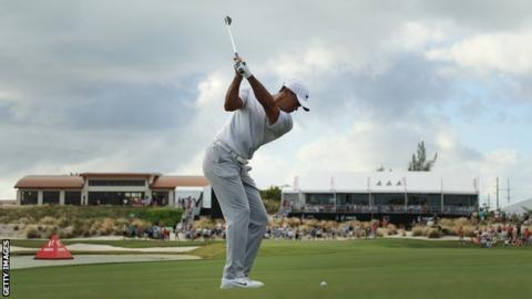 Tiger Woods takes a shot on the 18th at the Hero World Challenge