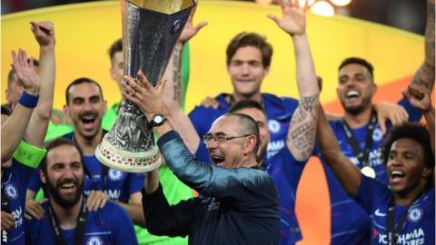 Chelsea head coach Maurizio Sarri lifts the Europa League trophy