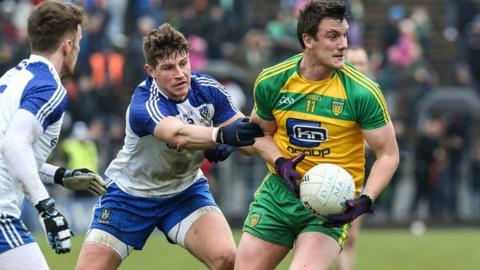 Monghan's Darren Hughes gets to grips with Donegal opponent Leo McLoone