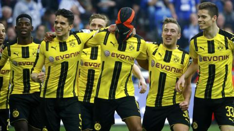 Borussia Dortmund's players celebrate scoring against Schalke
