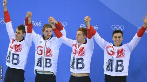 Stephen Milne, Duncan Scott, Dan Wallace celebrate on the podium, along with James Guy