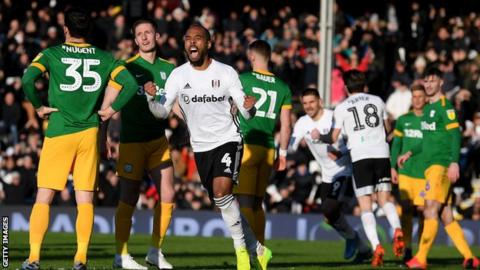 Fulham players celebrate David Nugent's own goal