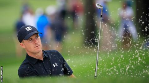 Jordan Spieth plays a shot out of a bunker