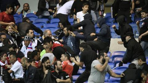 Violent scenes led to the Europa League fixture being delayed by 45 minutes
