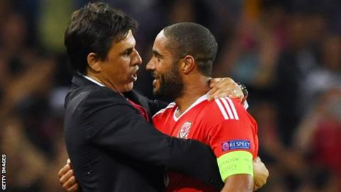 Chris Coleman and Wales captain Ashley Williams celebrate after they beat Russia