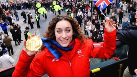 Amy Williams holding her gold medal