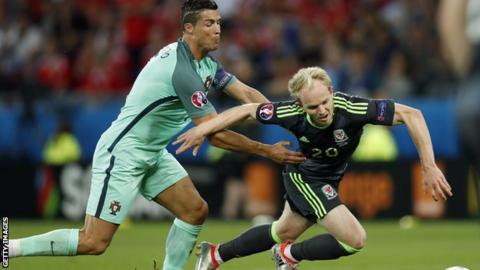 Jonny Williams is tackled by Cristiano Ronaldo
