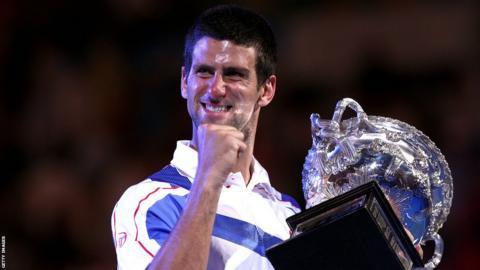 Novak Djokovic with the Australian Open trophy in 2011