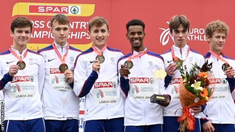 Great Britain's under-20 men's squad smile on the podium after winning team gold at the European Cross Country Championships in Lisbon