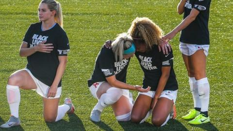Casey Short (centre right) was embraced by captain Julie Ertz (centre left)