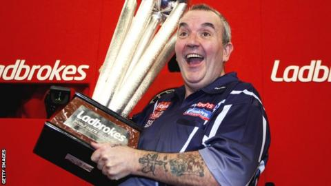 Phil Taylor lifts the Sid Waddell Trophy