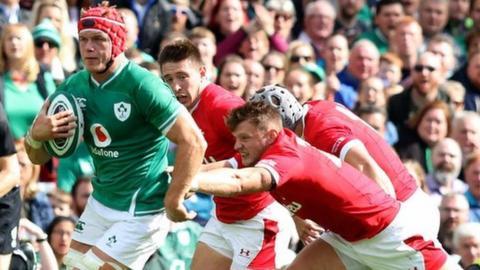 Welsh defenders try to halt the progress of Josh van der Flier in Dublin