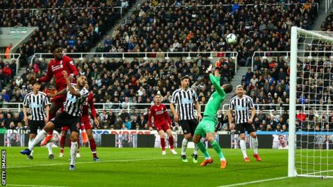 Divock Origi heads in Liverpool's winner against Newcastle