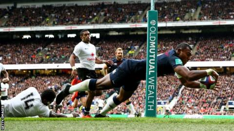Semesa Rokoduguni dives over to score for England