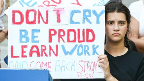 "Nice, France, 6 July: This England fan holds up a banner saying ""Don't cry, be proud, learn, work and come back stronger"" after the Lionesses 2-1 defeat against Sweden in the third-place match at the Women's World Cup. (Photo by Zhizhao Wu/Getty Images)"