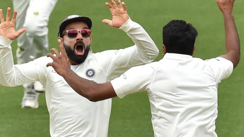 India captain Virat Kohli and spin bowler Ravichandran Ashwin celebrate victory over Australia in the first Test