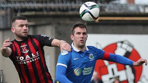 Crusaders defender Colin Coates battles with Linfield's Andrew Waterworth during the last game between the clubs in April