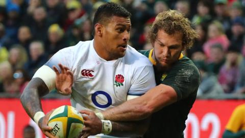 England's Nathan Hughes is tackled