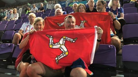Commonwealth Games spectators waving Manx flag
