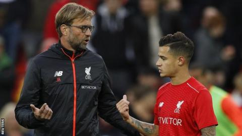 Liverpool manager Jurgen Klopp (left) and Reds playmaker Philippe Coutinho