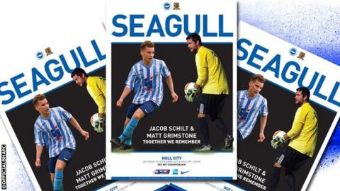 Shoreham air crash victims Jacob Schilt and Matt Grimstone feature on the cover of the match programme for Brighton's Championship match at home to Hull