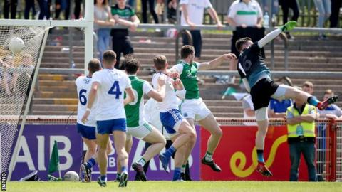 Eoin Donnelly (second from right) fists in Fermanagh's late clinching goal in Omagh