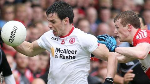Tyrone's Mattie Donnelly in action against Brendan Rogers of Derry
