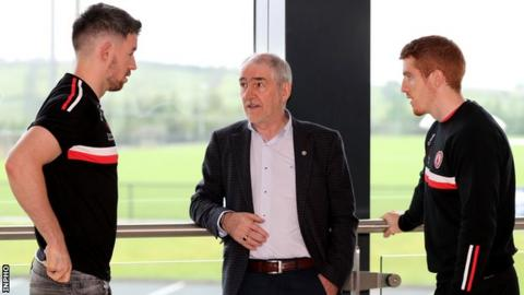 Tyrone boss Mickey Harte speaks to players Mattie Donnelly (left) and Peter Harte (right) at Tyrone's media event on Monday