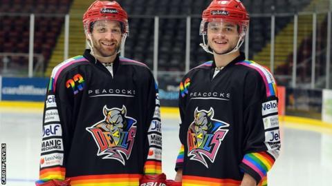 Evan Mosey and Sam Duggan show off the pride jerseys
