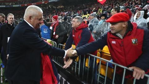 Warren Gatland shakes hands with a Lions fan