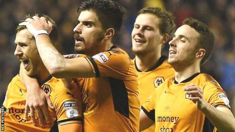 Barry Douglas celebrates with this Wolves team-mates after scoring their second goal against Brentford in the Championship