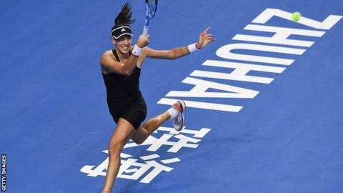 Wang Qiang through to final after crushing Muguruza class=