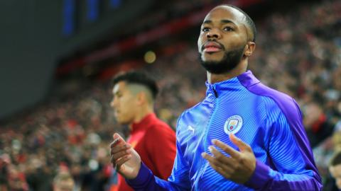 Raheem Sterling walks out at Anfield for Manchester City