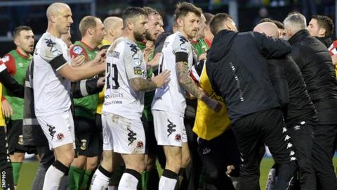 Players and backroom staff get involved in a melee at the Oval last weekend