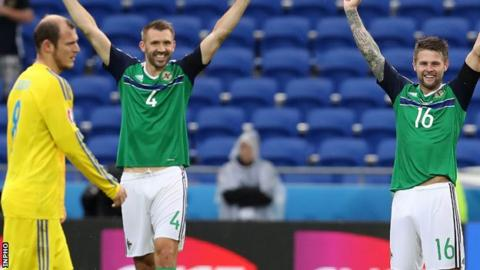 Oliver Norwood (right) and Gareth McAuley celebrate after Northern Ireland's win over Ukraine at Euro 2016