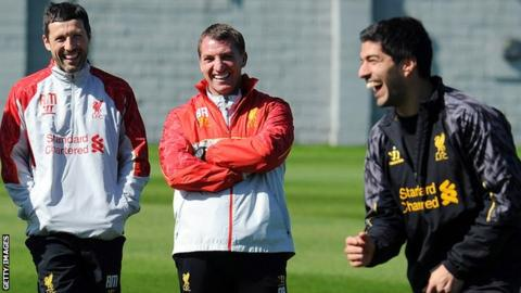 Ryland Morgans with Brendan Rodgers and Luis Suarez
