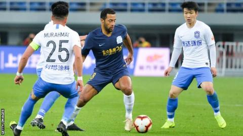 Mousa Dembele in action in China