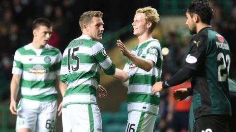 Kris Commons (left) and Gary Mackay-Steven celebrate Celtic's opening goal