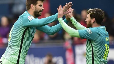 Gerard Pique and Lionel Messi