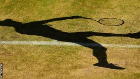 Silhouette of a tennis player