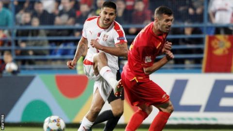 Aleksandar Mitrovic scores his second goal for Serbia