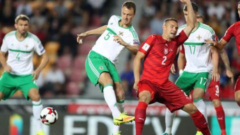 Northern Ireland's Jonny Evans attempts to tackle Czech Republic's Pavel Kaderabek