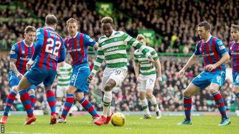 Celtic striker Moussa Dembele is tracked by a clutch of Inverness players in their league game at Celtic Park last November