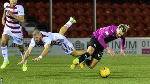Alex Gogic brings down