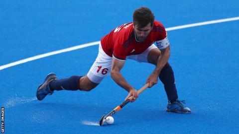 Great Britain men's hockey captain Adam Dixon prepares to pass the ball