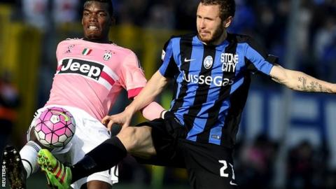Paul Pogba of Juventus and Jasmin Kurtic of Atalanta