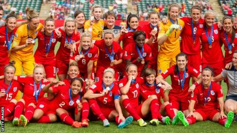 England's women celebrate finishing third at the 2015 World Cup