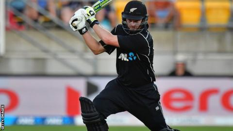 Colin Munro cuts the ball through the off-side for New Zealand against England