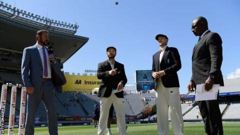 New Zealand captain Kane Williamson tosses the coin in front of England captain Joe Root